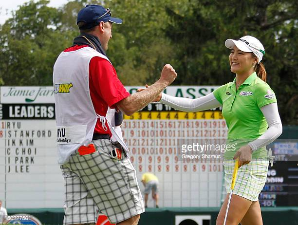 So Yeon Ryu of South Korea celebrates with her caddie Tom Watson after posting a leading score of -20 during the final round of the the Jamie Farr...