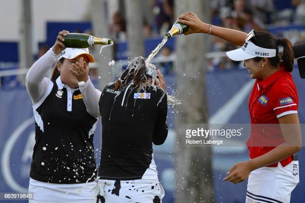 So Yeon Ryu of South Korea celebrates with Inbee Park and Mi Jung Hur also of South Korea after winning the ANA Inspiration on the Dinah Shore...