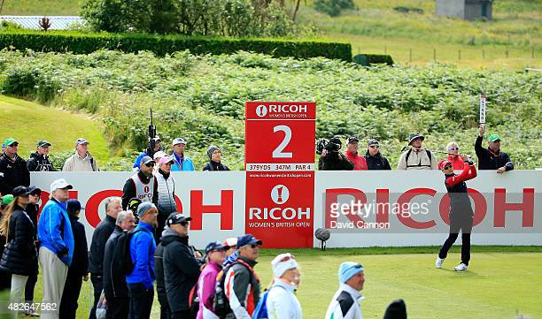 So Yeon Ryu of South Korea hits her tee shot on the 2nd hole watched by Donald and Ivanka Trump during the Third Round of the Ricoh Women's British...