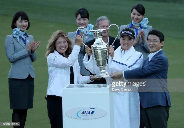 So Yeon Ryu of South Korea is presented with the trophy by Shinya Katanozaka the CEO of ANA and Melissa Montgomery Dinah Shore's daughter after her...