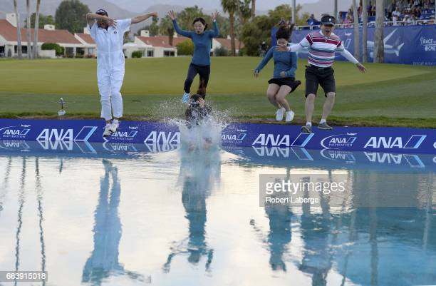 So Yeon Ryu of South Korea jumps in the water with her caddie Tom Watson her mother KwangJa Cho her sister SoMyung Ryu and guest SangJin Jang after...