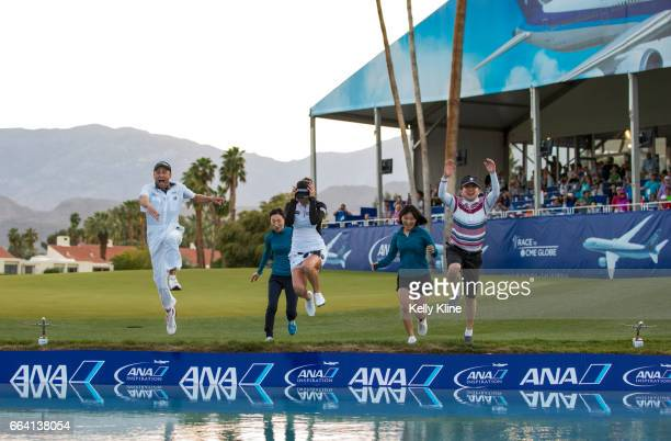 So Yeon Ryu of South Korea jumps into Poppy's pond after defeating Lexi Thompson in a playoff to win the 2017 ANA Inspiration at Mission Hills...