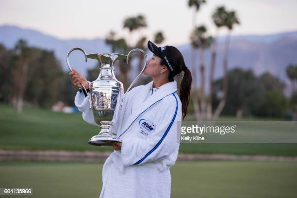 So Yeon Ryu of South Korea kisses the trophy after defeating Lexi Thompson in a playoff to win the 2017 ANA Inspiration at Mission Hills Country Club...