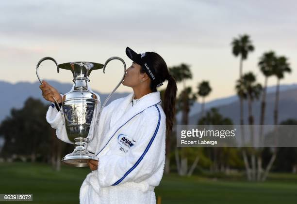 So Yeon Ryu of South Korea kisses the winner's trophy after winning the ANA Inspiration on the Dinah Shore Tournament Course at Mission Hills Country...