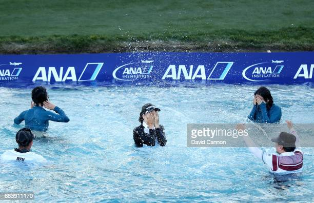 So Yeon Ryu of South Korea leaps into 'Poppy's Pond' with her caddie Tom Watson her mother Kwung Ja Cho her sister Somyung Ryu and her manager Sang...