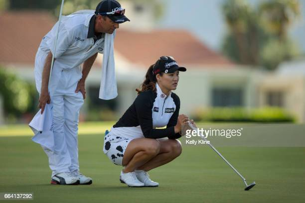 So Yeon Ryu of South Korea looks over the green with her caddie on the 18th hole during the 2017 ANA Inspiration at Mission Hills Country Club on...