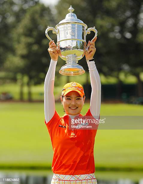 So Yeon Ryu of South Korea poses with the trophy after winning in a playoff against Hee Kyung Seo of South Korea during the final round of the U.S....
