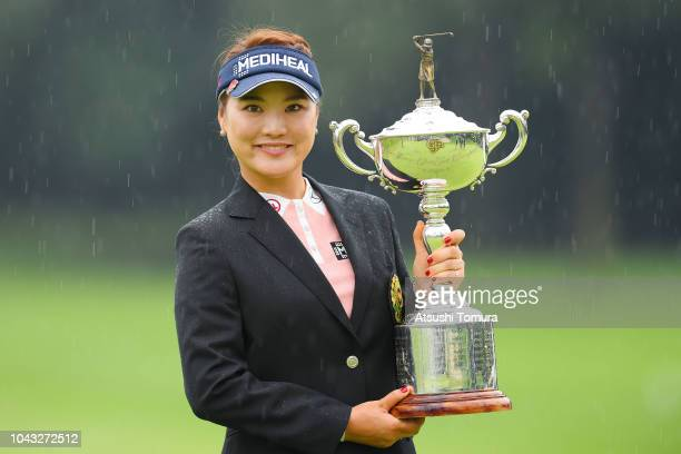 So Yeon Ryu of South Korea poses with the trophy after winning the Japan Women's Open Golf Championship at Chiba Country Club Noda Course on...