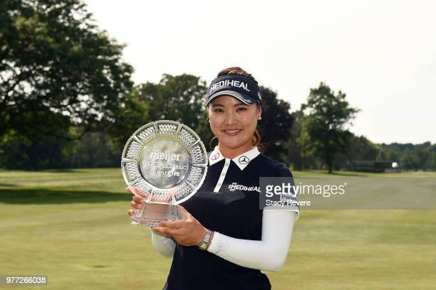 So Yeon Ryu of South Korea poses with the winner's trophy after winning the Meijer LPGA Classic for Simply Give at Blythefield Country Club on June...