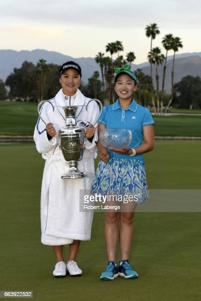 So Yeon Ryu of South Korea poses with the winner's trophy with Lucy Li with her best amateur trophy after winning the ANA Inspiration on the Dinah...