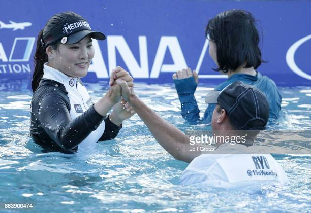 So Yeon Ryu of the Republic of Korea celebrates with her caddie Tom Watson after defeating Lexi Thompson in a playoff during the final round of the...