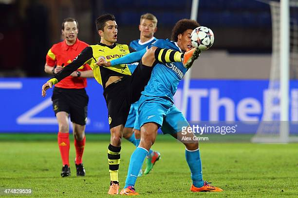 So28 of Zenit is challenged by Nuri Sahin of Dortmund during the UEFA Champions League Round of 16 match between FC Zenit and Borussia Dortmund at...