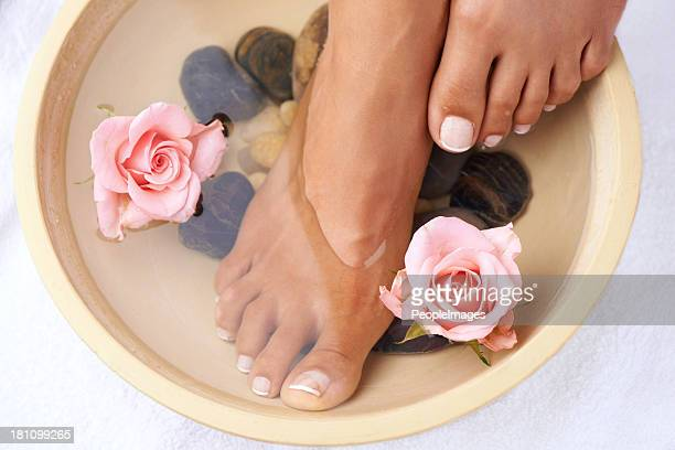 soaking in nature's goodness - beautiful female feet stock photos and pictures