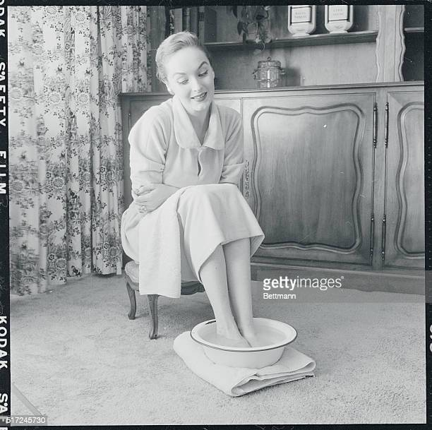Soaking up solid comfort Miss Lord rests her feet in a pan of scented water in the comfort of her living room Spraying on hot and cold water from a...