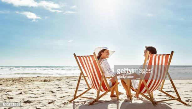 soaking up some good times together - outdoor chair stock pictures, royalty-free photos & images