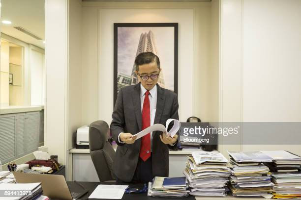 Soam Heng Choon chief executive officer of IJM Corp looks through some papers at his office before an interview in Kuala Lumpur Malaysia on Tuesday...