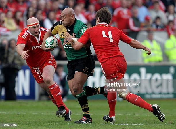 Soane Tonga'huia of Northampton charges forward past John Hayes and Donncha O'Callaghan during the Heineken Cup quarter final match between Munster...
