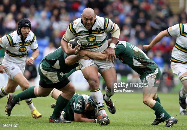 Soane Tonga'uhia of Northampton charges past Faan Rautenbach and Paul Hodson during the Guinness Premiership match between London Irish and...