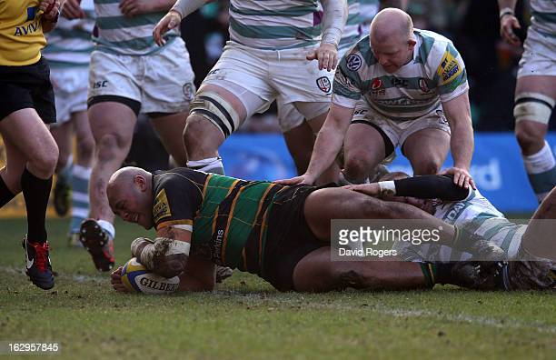 Soane Tonga'uiha of Northampton dives over for their third try during the Aviva Premiership match between Northampton Saints and London Irish at...