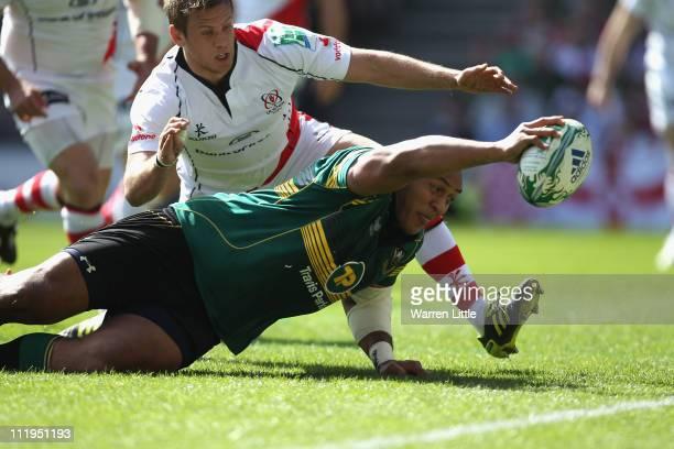 Soane Tonga'uiha of Northampton Saints stretches to score the opening try during the Heineken Cup Quarter Final match between Northampton Saints and...