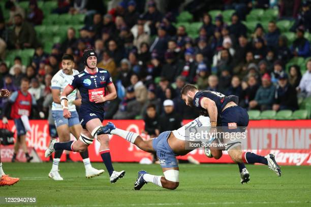 Soane Vikena of the Blues gets tackled during round one of the Super Rugby Trans Tasman match between the Melbourne Rebels and Blues at AAMI Park on...