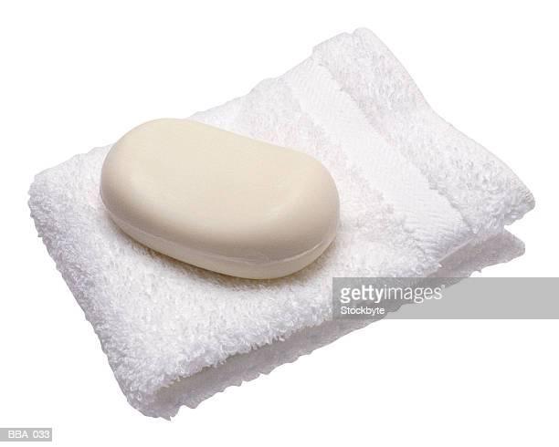 Soap bar on folded towel