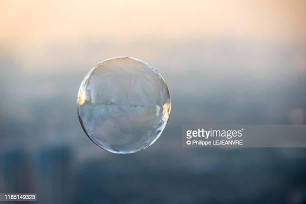 soap bubble against city aerial view - 球体 ストックフォトと画像