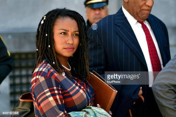 Soap bubbles fill the air above Bill Cosby as he stands behind Rennee Benson and Andrew Wyatt when his spokesperson delivers a statement to the press...