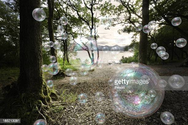 soap bubbles in a forest - theasis stock pictures, royalty-free photos & images