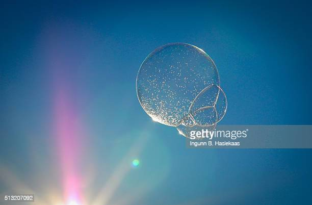 Soap bubbles with sun flare and sparks