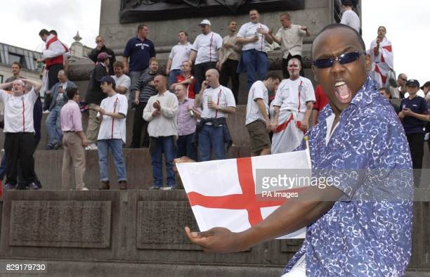 BBC soap EastEnders actor Mohammed George who plays the character Gus joins in the post match celebrations at Trafalgar Square in central London...