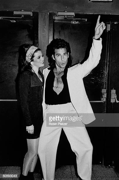 Soap opera actors Yasmine Bleeth and Ricky Paull Goldin attending a 1970'sthemed AIDS fundraising event