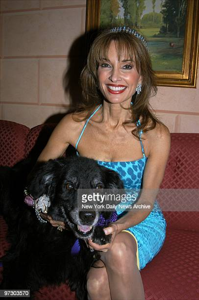 Soap star Susan Lucci cuddles Devlin a cancer survivor during the Tails and Tiaras dinner party at the Doubles Club in the Sherry Netherland hotel on...