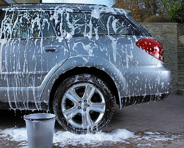 soap suds and water on car - cleaning the vehicle stock pictures, royalty-free photos & images