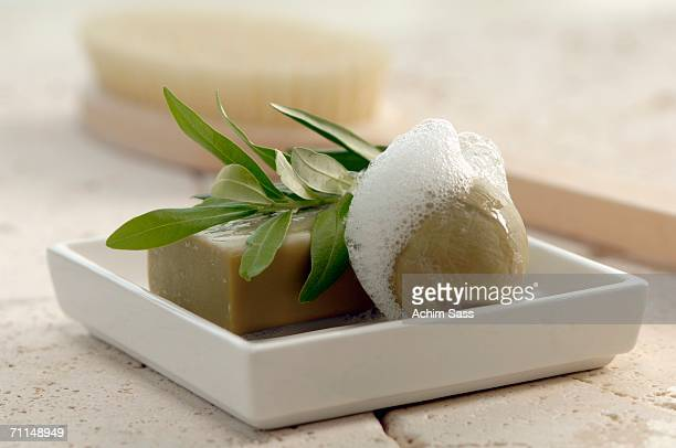 Soaps with herbal leaf on soap dish