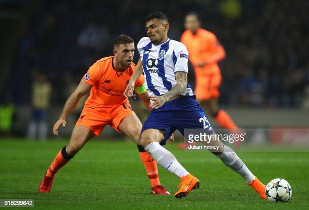 Soares of FC Porto holds off Jordan Henderson of Liverpool during the UEFA Champions League Round of 16 First Leg match between FC Porto and...