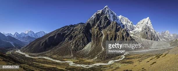 Soaring mountain peaks panorama remote Himalayan valley Khumbu Nepal