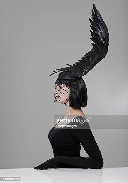 soaring to new heights in fashion - headdress stock pictures, royalty-free photos & images