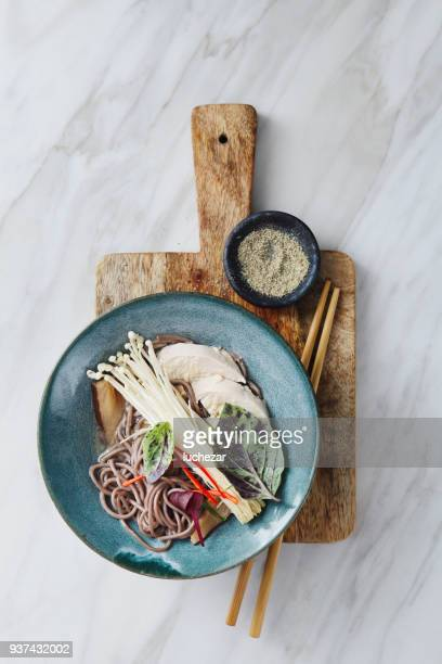 soba noodle soup with chicken and japanese mushroom - japanese food stock pictures, royalty-free photos & images