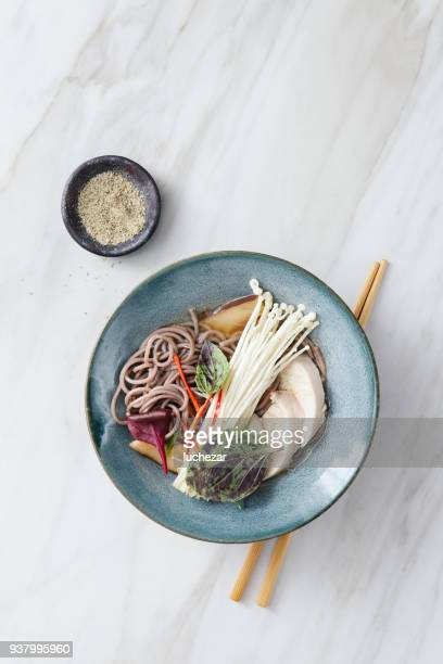 soba noodle soup with chicken and japanese mushroom - enoki mushroom stock pictures, royalty-free photos & images