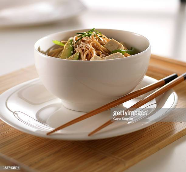Soba noodles and tofu in white bowl