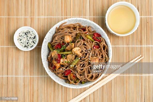 soba noodles with mushrooms, vegetables, tofu - soba stock pictures, royalty-free photos & images