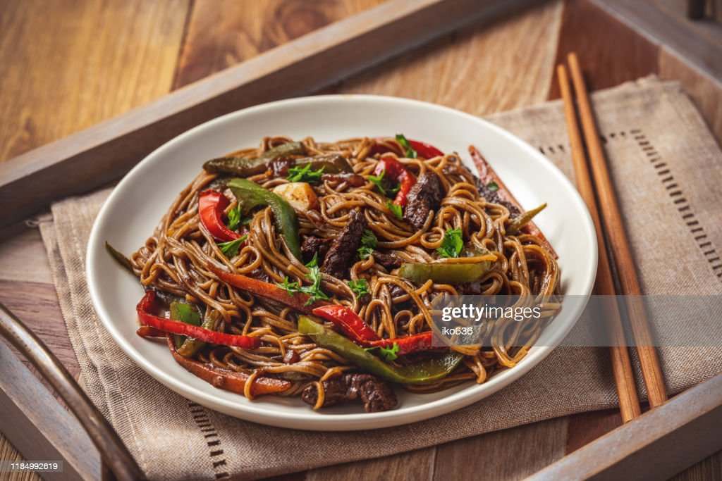 Soba noodles with vegetables and beef, asian style cuisine. : Stock Photo