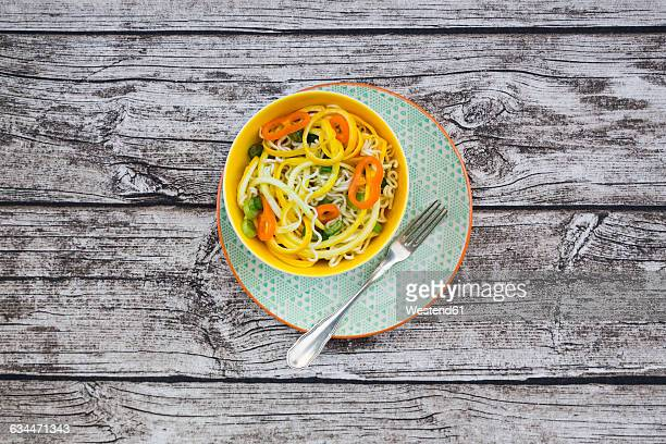 Soba noodles, yellow zucchini, mini pepper and spring onion in bowl