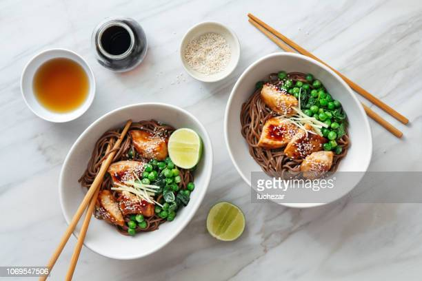 soba with glazed chicken, sesame, green pea and sprouts - soba stock pictures, royalty-free photos & images