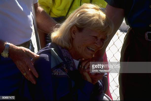 Sobbing Peggy Smith clutching Pres Bill Clinton's hand later consoling residents who lost their homes to destructive tornado at Ponderosa rv park