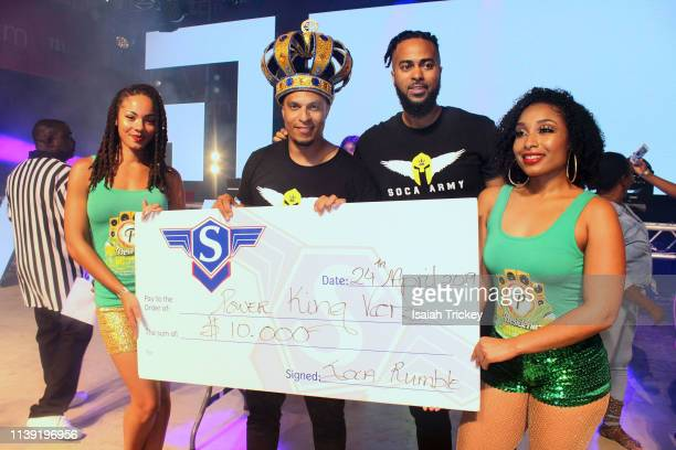 Soca artist King Vers winner of the Power category of Soca Ramble poses on stage during St Maarten Carnival at The St Maarten Festival Village on...