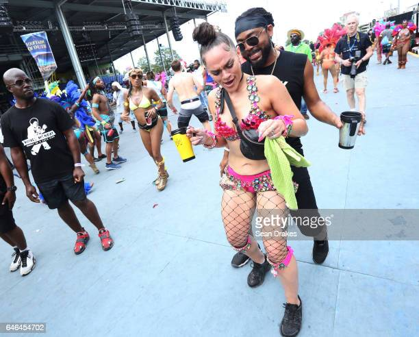 Soca artist Machel Montano dances with a masquerader in Fantasy mas band in the Queen's Park Savannah during Trinidad Carnival on February 28, 2017...