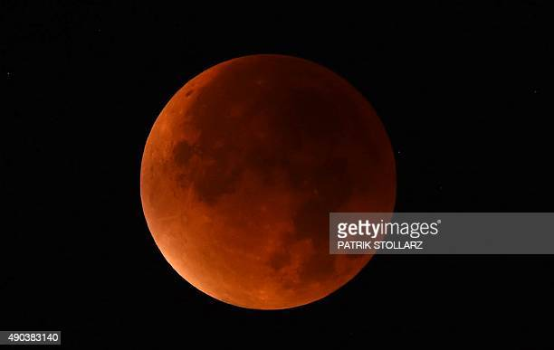 A socalled 'blood moon' can be seen during a total lunar eclipse in Essen western Germany on September 28 2015 Skygazers were treated to a rare...