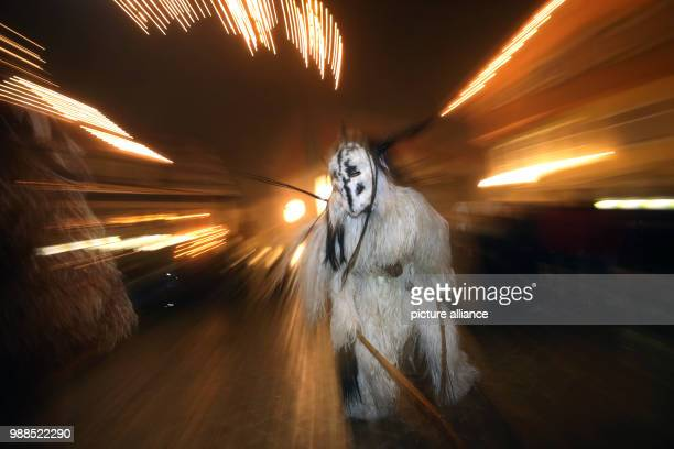 """So-called """"Klausen"""" can be seen in the inner city of Sonthofen, Germany, 5 December 2017. The custom sees young men dress up with masks and furs,..."""